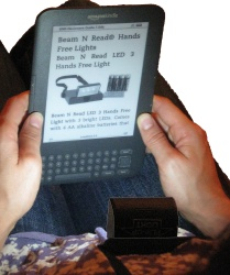 Beam N Read LED 3 Hands Free Light lighting up Amazon Kindle