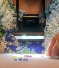 Kelly Jackson of IHaveANotion.com hand quilting with Beam n Read LED 6 Deluxe Hands-Free Light